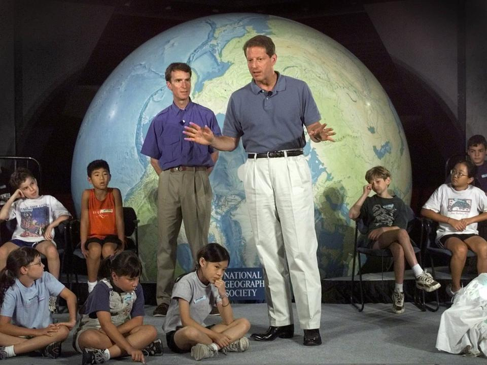 "FILE - In this Aug. 2, 1999, file photo Vice President Al Gore, accompanied by Bill Nye ""The Science Guy"" gestures while talking about climate change to summer camp students at the National Geographic Society in Washington. (AP Photo/Khue Bui, File)"