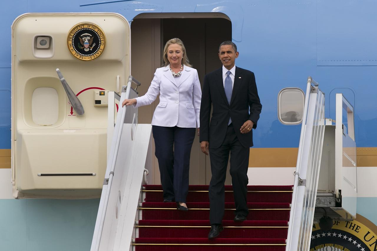 YANGON, MYANMAR - NOVEMBER 19: US President Barack Obama and Secretary of State Hilary Clinton arrive at Yangon International airport during his historical first visit to the country on November 19, 2012 in Yangon, Myanmar. Obama is the first US President to visit Myanmar while on a four-day tour of Southeast Asia that also includes Thailand and Cambodia. (Photo by Paula Bronstein/Getty Images)