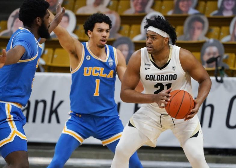 Colorado forward Evan Battey, right, is trapped with the ball by UCLA guard Jules Bernard.