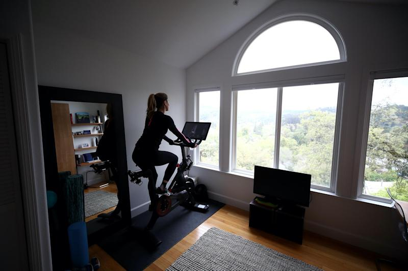 Cari Gundee rides her Peloton exercise bike at her home on April 06, 2020 in San Anselmo, California. More people are turning to Peloton due to shelter-in-place orders because of the coronavirus (COVID-19). Peloton stock has continued to rise over recent weeks even as most of the stock market has plummeted: Ezra Shaw/Getty Images