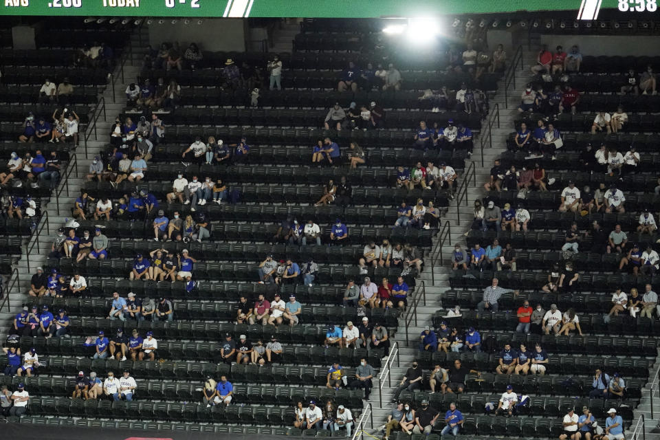 Fans watch during the fifth inning in Game 1 of the baseball World Series between the Los Angeles Dodgers and the Tampa Bay Rays Tuesday, Oct. 20, 2020, in Arlington, Texas. (AP Photo/David J. Phillip)