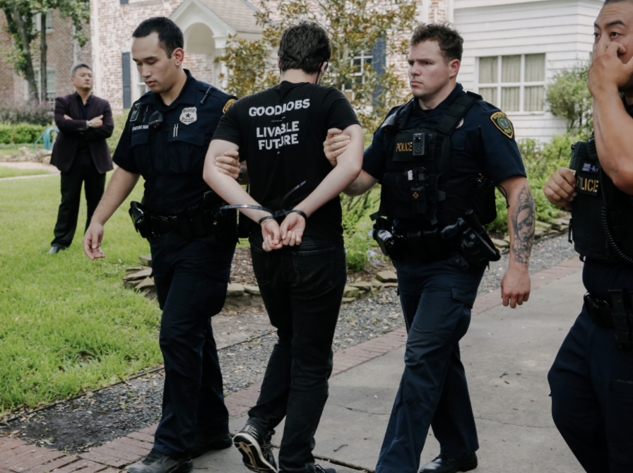 Young people protesting the climate crisis at the home of Republican Senator Ted Cruz in Texas are led away by police on Monday (Rachael Warriner)