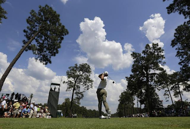 Adam Scott, of Australia, hits his tee shot on the 18th hole during a practice round for the U.S. Open golf tournament in Pinehurst, N.C., Wednesday, June 11, 2014. The tournament starts Thursday. (AP Photo/Eric Gay)