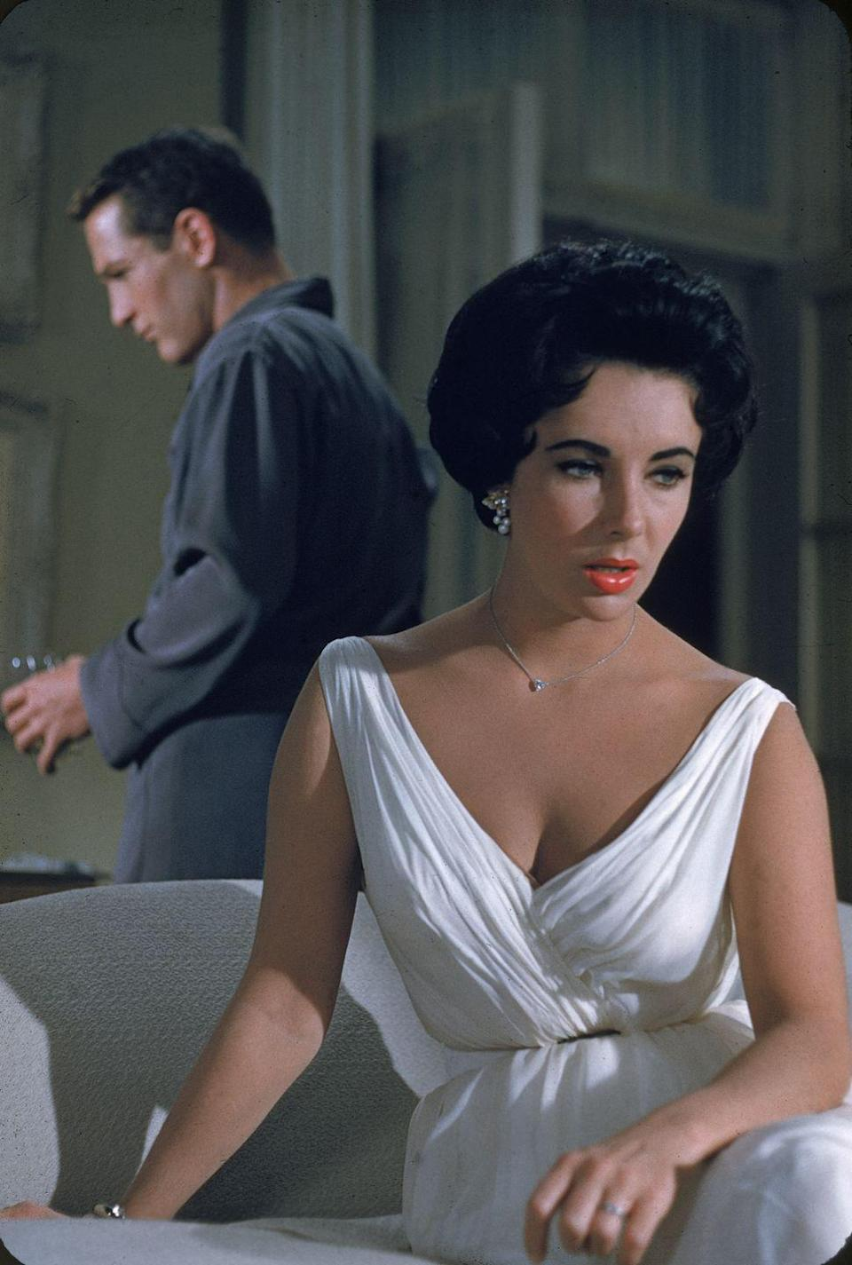 <p>Even off camera, Elizabeth Taylor brought glitz and glamour wherever she went — so her solitaire diamond pendant was actually an understatement in <em>Cat on a Hot Tin Roof</em>. The film star topped off the chic look with a pair of pearl and diamond cluster earrings. </p>