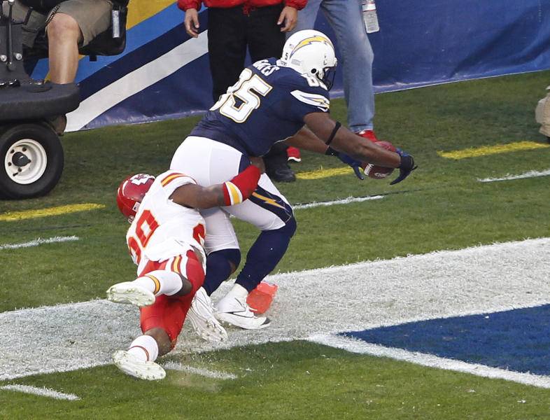 San Diego Chargers tight end Antonio Gates scores a touchdown as Kansas City Chiefs strong safety Eric Berry hangs on during the first quarter of an NFL football game Thursday, Nov. 1, 2012, in San Diego. (AP Photo/Lenny Ignelzi)
