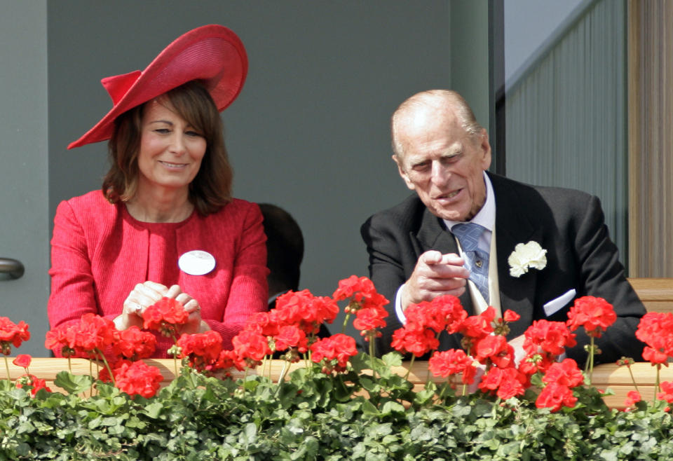 Carole Middleton and Prince Philip, Duke of Edinburgh watch the horses in the parade ring as they attend Ladies Day during Royal Ascot