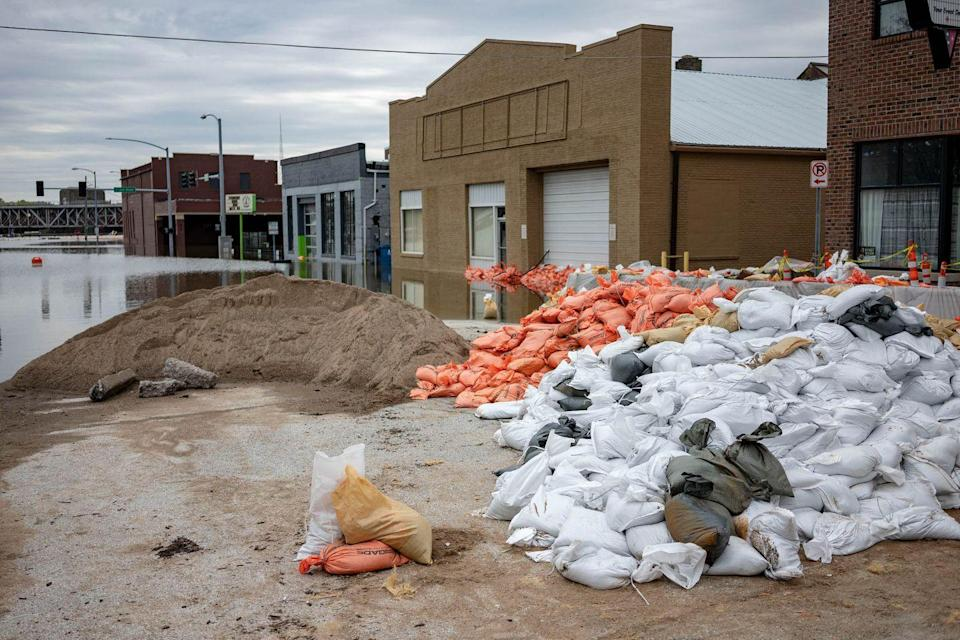 <p>Flood waters surround area businesses near the main breach in the Mississippi River in Davenport, Iowa on Friday, May 3, 2018.</p>