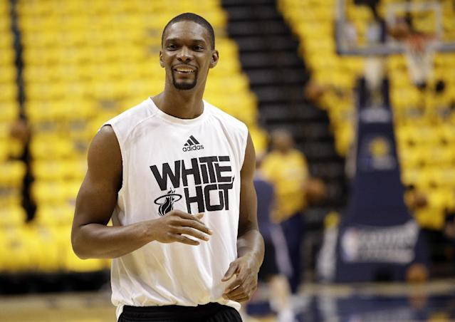 Miami Heat's Chris Bosh smiles as he warms up for game 1 of the Eastern Conference finals NBA basketball playoff series against the Indiana Pacers Sunday, May 18, 2014, in Indianapolis. (AP Photo/AJ Mast)