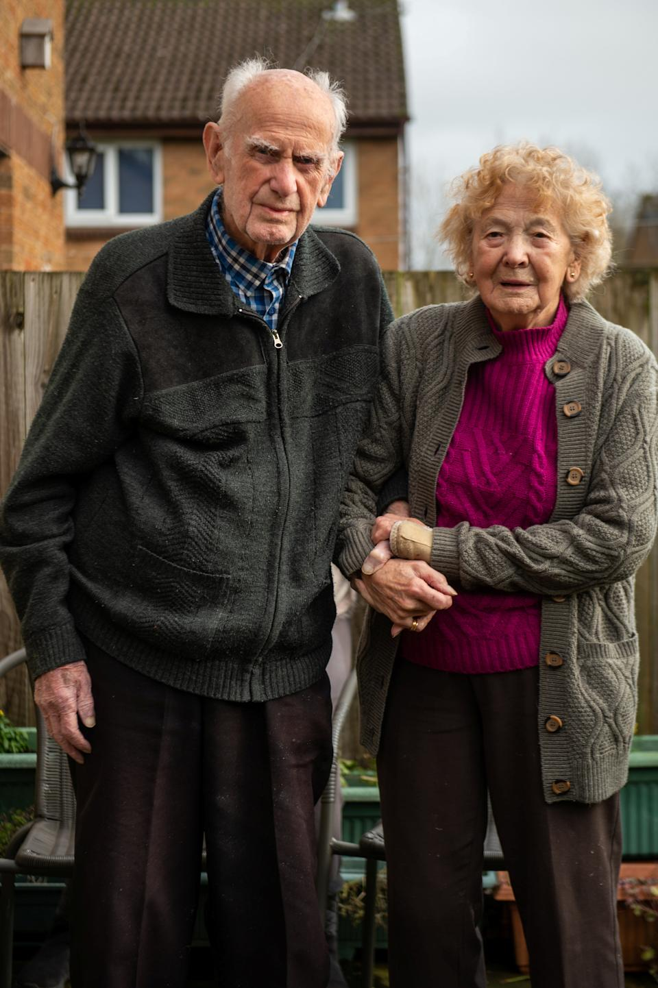 "Ron (100) and Beryl (98) Golightly, who have been married for 80 years, pictured at home near Harrogate, North Yorks. See SWNS story SWLEcouple; A husband and wife who met in their teens have become one of Britain's longest married couples after they celebrated their 80th wedding anniversary. Ron Golightly met his beloved Beryl when he was just 16 when one of his pals wolf-whistled at his future wife's friends as they walked past the group in the street. A 14-year-old Beryl turned round to see what was going on and instantly fell in love with Ron's curly hair and cheeky smile and the pair have been inseparable ever since. Beryl, now 98, said of Ron, now 100: ""I just knew as soon as I saw him I was going to marry him. ""I was 14 and Ron was 16, it was very much love at first sight. ""A couple of days later we spoke again and went for a walk, we were more or less a couple straight away. ""I thought he had whistled at me and I just fell in love with his cheeky grin straight away."" The couple tied the knot in their hometown of Harrogate, North Yorks., in 1941 while Ron, who served in the Brigadier Guards, was on leave from the Army during World War II."
