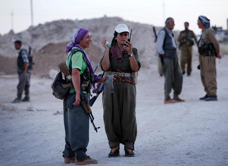 Female members of the Kurdistan Workers' Party (PKK) take position on the front line in Makhmur, south of Arbil, the capital of the autonomous Kurdish region of northern Iraq where clashes with Islamic State militants are ongoing on August 9, 2014