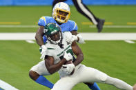 New York Jets wide receiver Breshad Perriman, bottom, catches a touchdown pass under Los Angeles Chargers cornerback Casey Hayward during the second half of an NFL football game Sunday, Nov. 22, 2020, in Inglewood, Calif. (AP Photo/Jae C. Hong)