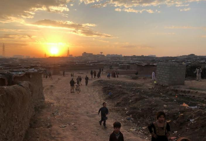 A general view of Afghan refugee camp during sun setting behind the horizon in Islamabad