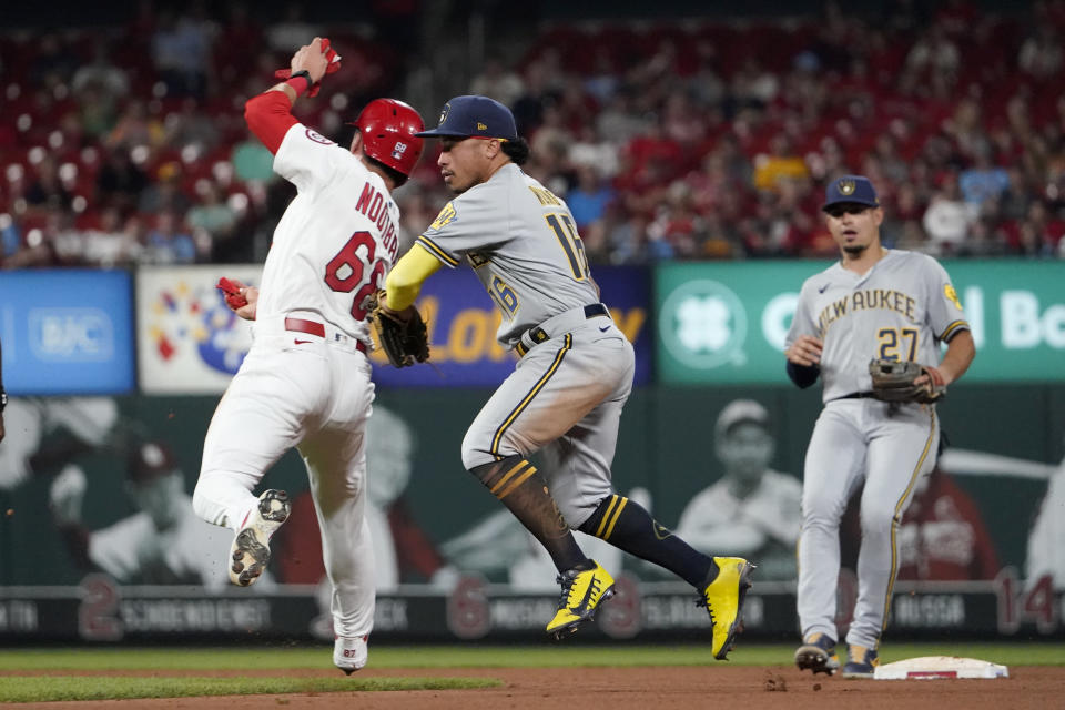 St. Louis Cardinals' Lars Nootbaar, left, is tagged out by Milwaukee Brewers second baseman Kolten Wong as Brewers shortstop Willy Adames (27) watches during the seventh inning of a baseball game Tuesday, Aug. 17, 2021, in St. Louis. (AP Photo/Jeff Roberson)