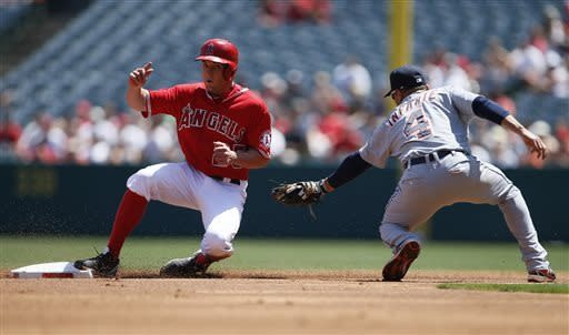 Los Angeles Angels' Peter Bourjos, left, steals second base past Detroit Tigers second baseman Omar Infante, right, on a wild pitch from pitcher Rick Porcello during the first inning of a baseball game on Saturday, April 20, 2013, in Anaheim, Calif. (AP Photo/Danny Moloshok)