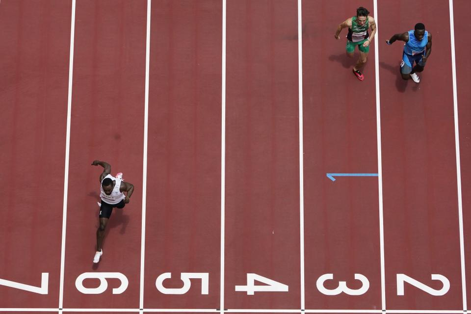 Dorian Keletela, of Refugee Olympic Team, wins his heat during the men's 100-meter at the 2020 Summer Olympics, Saturday, July 31, 2021, in Tokyo. (AP Photo/Morry Gash)