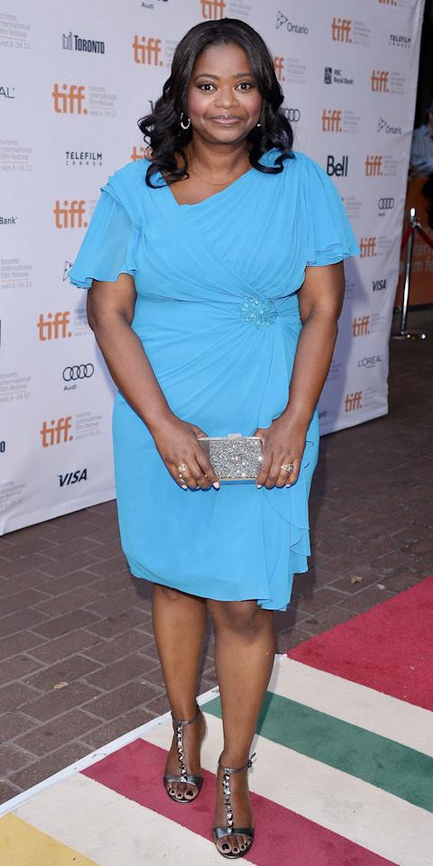 <p>Spencer attended the premiere of<em>Smashed</em>in a light blue short-sleeve dress that cinched at the waist. She accessorized with a sparkly clutch and T-strap sandals.</p>