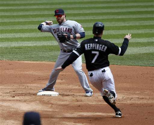 Cleveland Indians second baseman Jason Kipnis, left, turns the double play forcing Chicago White Sox's Jeff Keppinger at second and getting Alex Rios at first during the first inning of a baseball game Wednesday, April 24, 2013, in Chicago. (AP Photo/Charles Rex Arbogast)