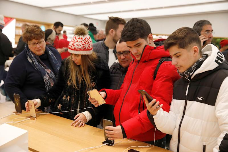 People look at products at the World Trade Center Apple Store during a Black Friday sales event in Manhattan, New York City, U.S., November 23, 2018. REUTERS/Andrew Kelly