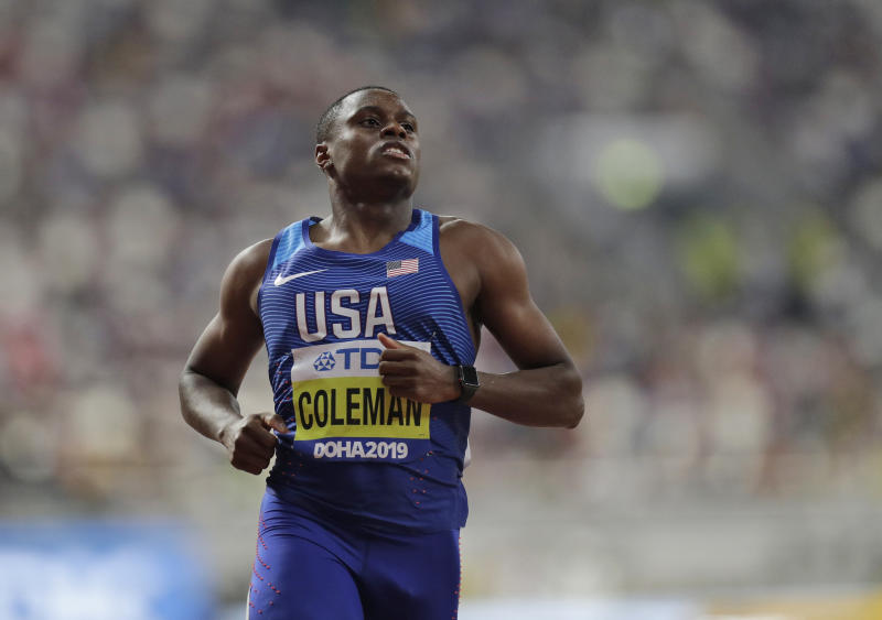 Christian Coleman of the United States competes during the men' 100 meters heats at the World Athletics Championships in Doha, Qatar, Friday, Sept. 27, 2019. (AP Photo/Petr David Josek)