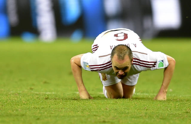 Spain's Andres Iniesta sinks to his knees during the group B World Cup soccer match between Spain and the Netherlands at the Arena Ponte Nova in Salvador, Brazil, Friday, June 13, 2014. (AP Photo/Manu Fernandez)