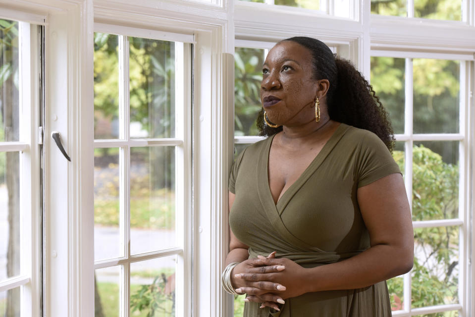 """FILE - In this Tuesday, Oct. 13, 2020 file photo, Tarana Burke, founder and leader of the #MeToo movement, stands for a portrait in her home in Baltimore. For Burke, her first reaction to the Wednesday, June 30, 2021, Pennsylvania court decision on Bill Cosby's release was """"shock, definitely shock."""" """"And as the shock settled in and I started seeing some of the (social media) commentary coming in … we, folks who do this work across the field, started huddling together to talk about what our response would be,"""" Burke said in an interview. """"It was just real concern for survivors. We're going to have a hard time sleeping."""" (AP Photo/Steve Ruark, File)"""