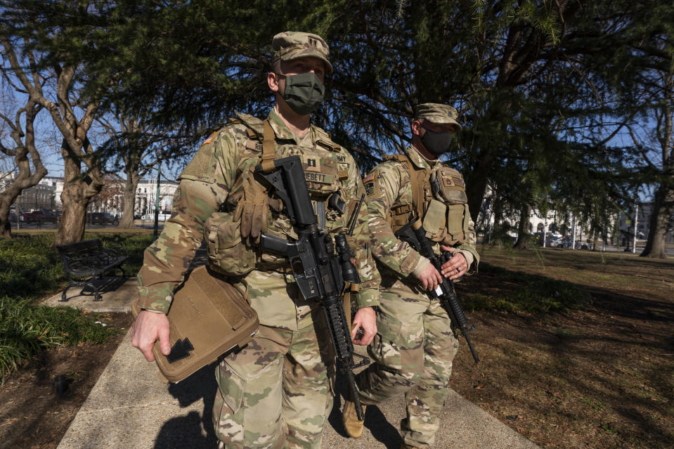Armed members of the Maryland National Guard secures the perimeter around the U.S. Capitol, Wednesday, Jan. 13, 2021, in Washington as the House of Representatives continues with its fast-moving House vote to impeach President Donald Trump, a week after a mob of Trump supporters stormed the U.S. Capitol. (AP Photo/Manuel Balce Ceneta)