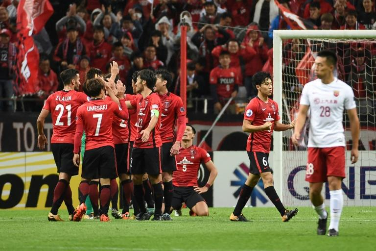 Japan's Urawa Red Diamonds players celebrate after winning their Asian Champions League semi-final match against China's Shanghai SIPG, in Saitama, on October 18, 2017