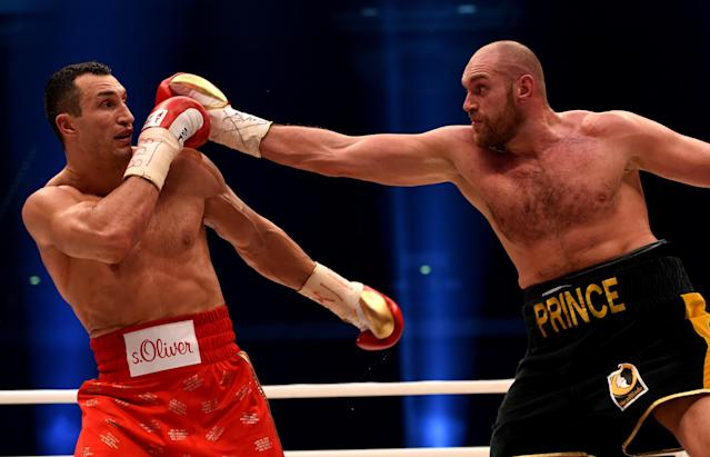 Tyson Fury (R) dethroned Wladimir Klitschko in a 12-round decision to become world heavyweight champion. (Getty Images)