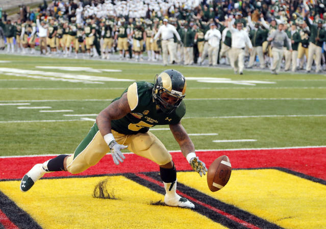 Colorado State running back Kapri Bibbs (5) recovers his fumble for a touchdown against Washington State during the second half of the NCAA New Mexico Bowl college football game, Saturday, Dec. 21, 2013, in Albuquerque, N.M. Colorado State won 48-45.(AP Photo/Matt York)