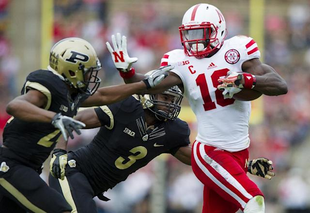 Nebraska's Quincy Enunwa (18) fends off Purdue's Leroy Clark (3) and Frankie Williams (24) during the second half of an NCAA college football game, Saturday, Oct. 12, 2013, in West Lafayette, Ind. Nebraska defeated Purdue 44-7. (AP Photo/Doug McSchooler)