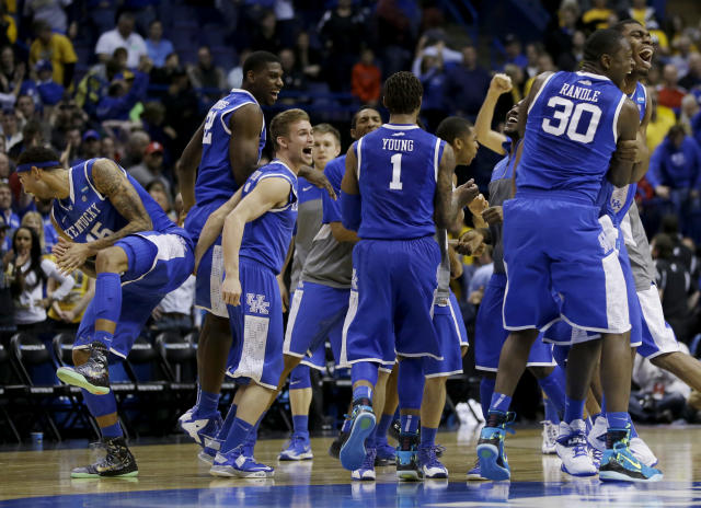 Kentucky celebrates after winning a third-round game against Wichita State at the NCAA college basketball tournament Sunday, March 23, 2014, in St. Louis. Kentucky won 78-76. (AP Photo/Jeff Roberson)
