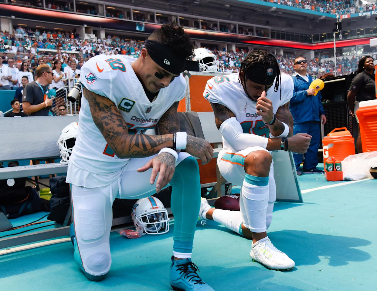 <p>Miami Dolphins Wide Receiver Kenny Stills (10), left, and Miami Dolphins Wide Receiver Albert Wilson (15) take a knee during the playing of the National Anthem prior to the start of the Miami Dolphins and Tennessee Titans game on Sunday, September 9, 2018 at Hard Rock Stadium in Miami Gardens, Fla. (Photo by Michele Sandberg/Icon Sportswire via Getty Images) </p>