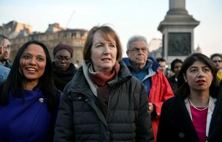 FILE PHOTO: Labour politician Harriet Harman joins a vigil in Trafalgar Square the day after an attack, in London