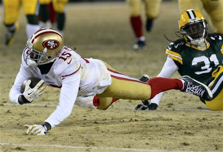Jan 5, 2014; Green Bay, WI, USA; San Francisco 49ers wide receiver Michael Crabtree (15) makes a diving catch against the Green Bay Packers during the second half of the 2013 NFC wild card playoff football game at Lambeau Field. San Francisco 49ers defeat the Green Bay Packers 23-20. Mandatory Credit: Mike DiNovo-USA TODAY Sports
