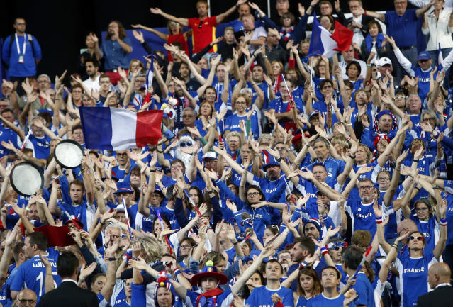 Supporters of the French tennis team wave before the Davis Cup France against Spain, Friday, Sept.14, 2018 in Lille, northern France. (AP Photo/Michel Spingler)