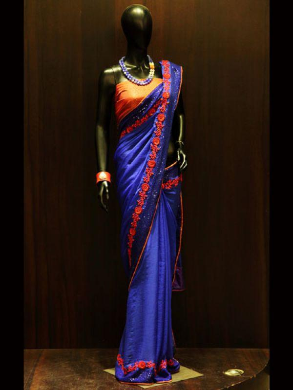 <p><strong>Images via : <a href='http://idiva.com'>iDiva.com</a></strong></p><p><strong>Royal touch</strong>: A must have for all the party goers. The Blue saree with orange borders is a sure shot eye catcher. Add the dazzling touch to your oufit by pairing it with beaded necklace to lend the simple yet classy feel to it.</p><p><strong>Related Articles - </strong></p><p><a href='http://idiva.com/photogallery-style-beauty/5-hot-ethnic-wear-trends/16258' target='_blank'>5 Hot Ethnic Wear Trends</a></p><p><a href='http://idiva.com/photogallery-style-beauty/diwali-spl-go-white-in-indian-wear/17287' target='_blank'>Diwali Spl: Go White in Indian Wear</a></p>