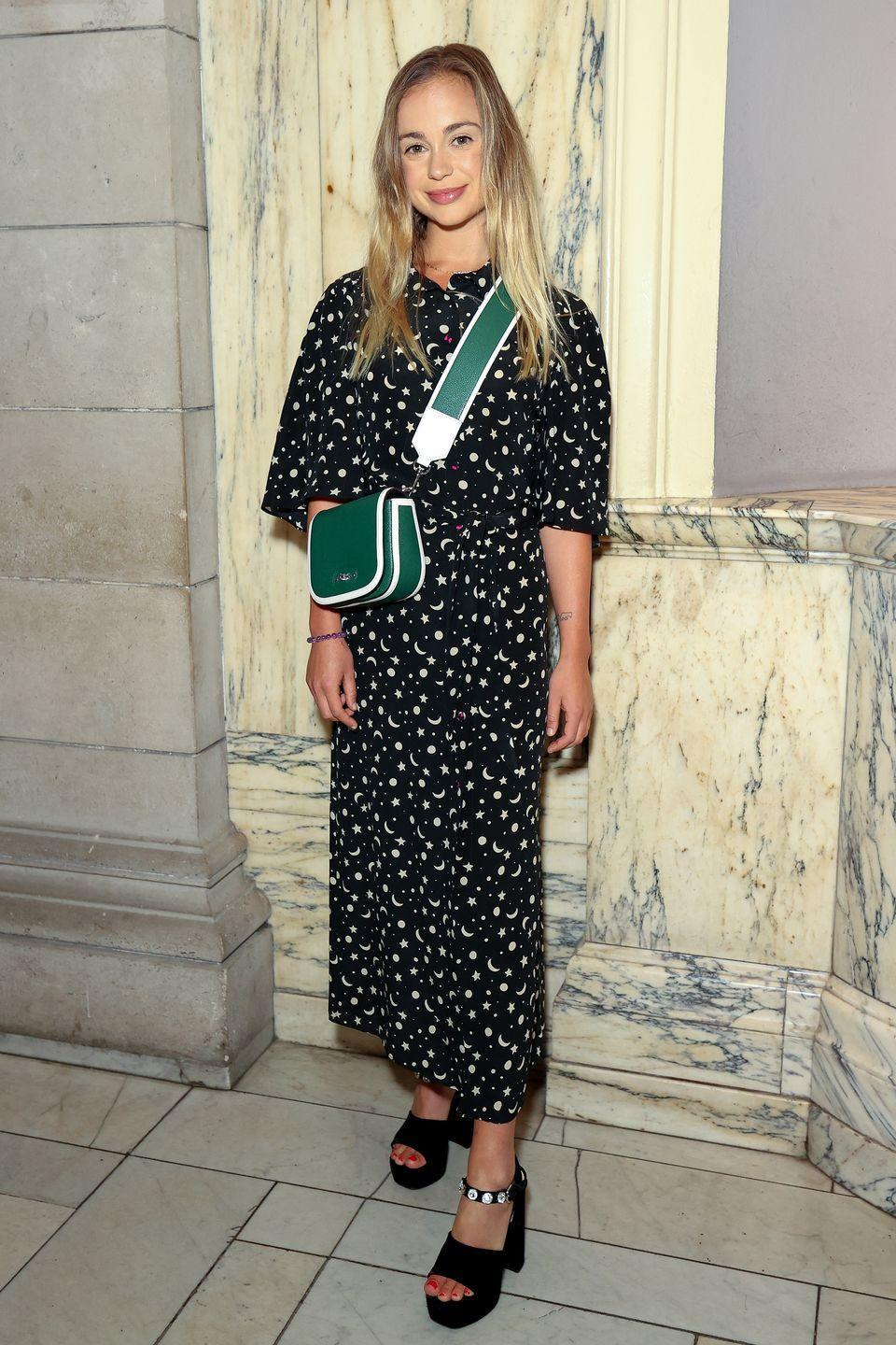 <p><strong>19 September</strong></p><p>Amelia Windsor wore a printed dress with a green crossbody bag. </p>