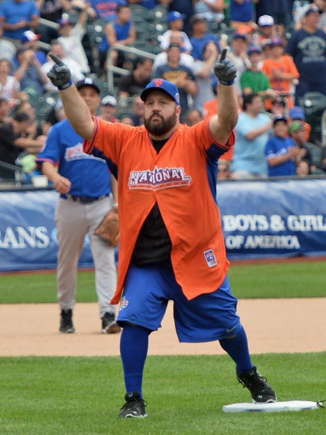NEW YORK, NY - JULY 14: Actor/comedian Kevin James celebrates after sliding into second base at the Taco Bell All-Star Legends & Celebrity Softball Game at Citi Field on July 14, 2013 in New York City. (Photo by Mike Coppola/Getty Images)