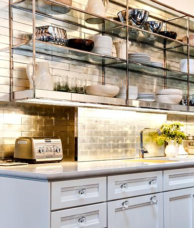 """Goldleaf is sandwiched between glass in <a href=""""http://bit.ly/SOrTb0"""" rel=""""nofollow noopener"""" target=""""_blank"""" data-ylk=""""slk:Ann Sacks' Davlin tile"""" class=""""link rapid-noclick-resp"""">Ann Sacks' Davlin tile</a>; prices start at about $180 per square foot. This photo is from the <a href=""""http://bit.ly/UxHeKn"""" rel=""""nofollow noopener"""" target=""""_blank"""" data-ylk=""""slk:2012 House Beautiful Kitchen of the Year"""" class=""""link rapid-noclick-resp"""">2012 House Beautiful Kitchen of the Year</a>. (Photo credit: Aaron Wojack via Ann Sacks)"""