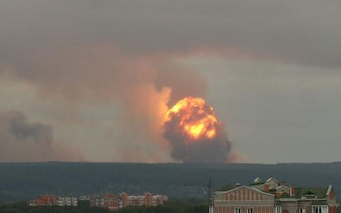 Flame and smoke rising from the site of blasts at an ammunition depot near the town of Achinsk in Krasnoyarsk region, Russia August 5, 2019 - Credit: DMITRY DUB/ REUTERS