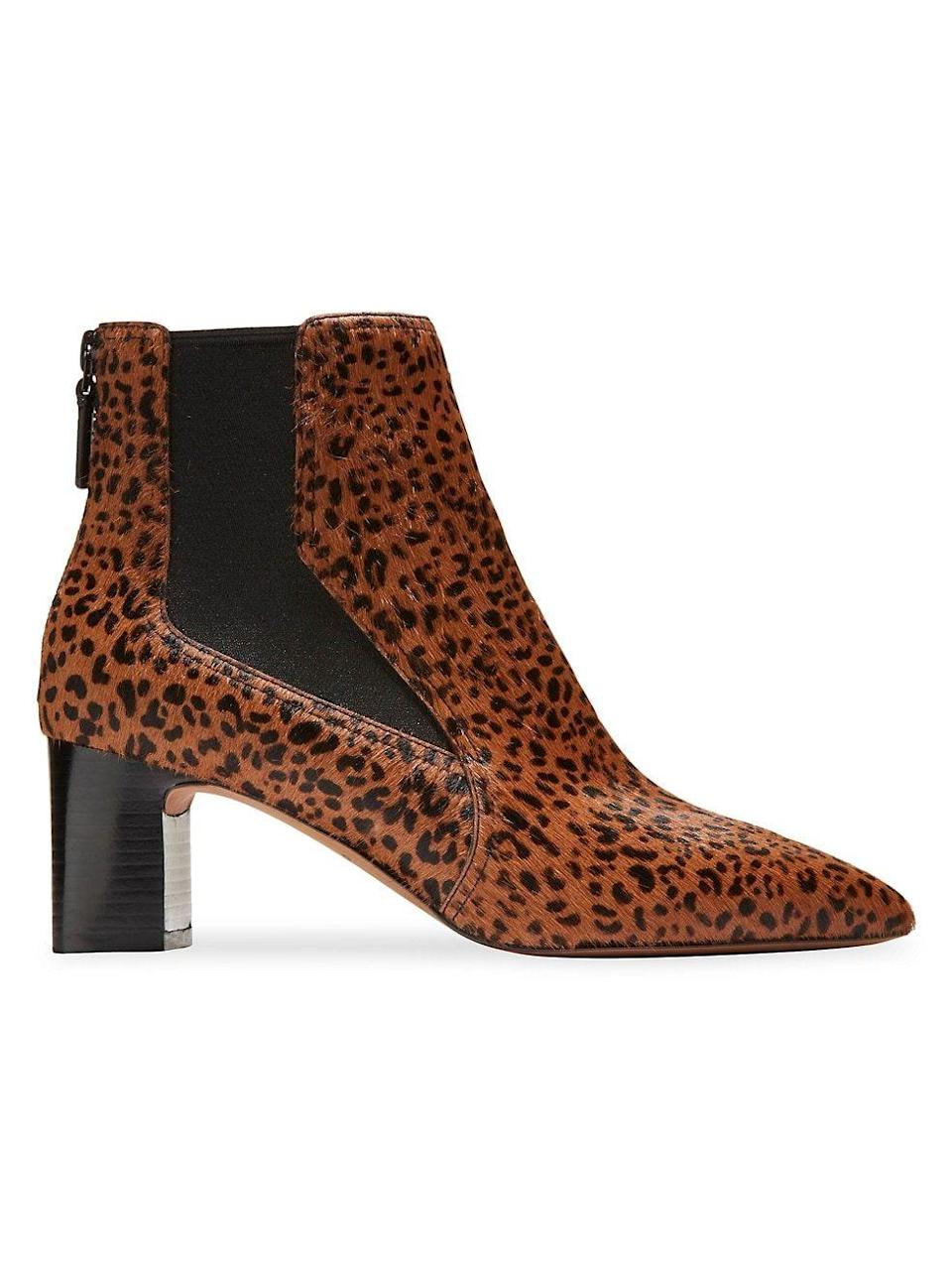 """<p><strong>Cole Haan</strong></p><p><strong>$280.00</strong></p><p><a href=""""https://go.redirectingat.com?id=74968X1596630&url=https%3A%2F%2Fwww.saksfifthavenue.com%2Fproduct%2Fcole-haan-etta-leopard-print-calf-hair-booties-0400014873991.html&sref=https%3A%2F%2Fwww.townandcountrymag.com%2Fstyle%2Ffashion-trends%2Fg28225508%2Ffall-boots%2F"""" rel=""""nofollow noopener"""" target=""""_blank"""" data-ylk=""""slk:Shop Now"""" class=""""link rapid-noclick-resp"""">Shop Now</a></p><p>Animal print is a perfect more-exciting-than-neutral answer to neutral booties. </p>"""