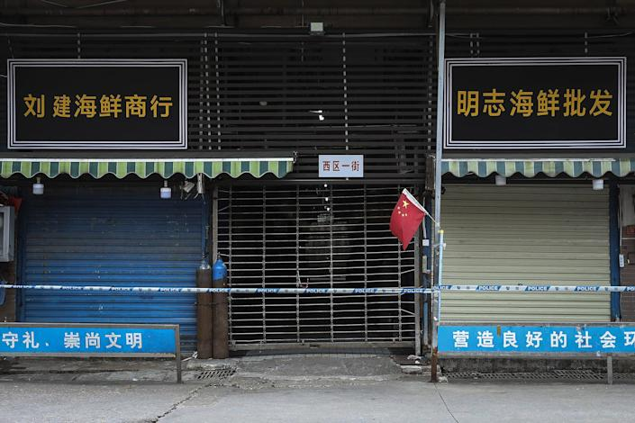 Image: The closed Huanan Seafood Wholesale Market, where some of the first reported cases were traced to. (Getty Images)