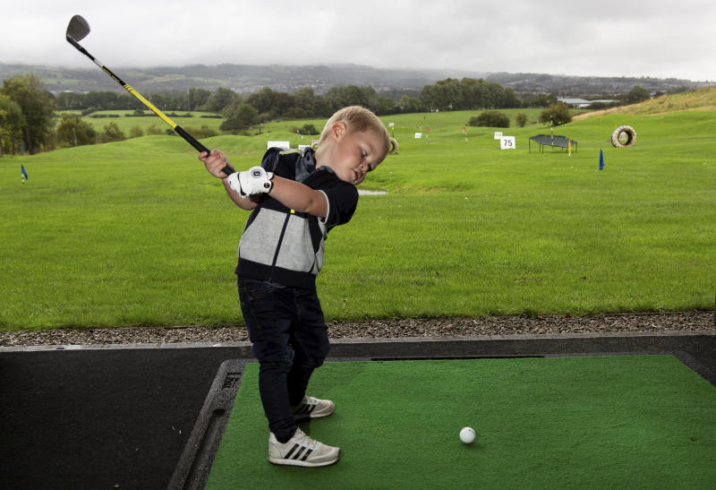 "Three-year-old George Hughes can already hit the ball 100 years. (Credit: SWNS) George Hughes (3). A talented toddler who has already been playing golf half his life has been hailed the next Rory McIlroy because of his exceptional skill off the tee. See SWNS story SWLEgolf. Little George Hughes can already drive, pitch and putt the ball despite only celebrating his third birthday last month. His longest shot to date is 100 yards and earlier this year he completed an entire hole for the first time in 11 shots. The little lad regularly takes to the course with his own set of clubs and a tiny glove but he can't wear golf shoes or clothing yet as no brand make them in his size. George's golf mad granddad Tony Sedgwick, 48, sparked the youngster's love of the game when he bought him a set of plastic toy clubs 18 months ago. ""It's really fun going to the golf range and to the golf course with my granddad,"" George said. ""I love whacking the golf ball."""
