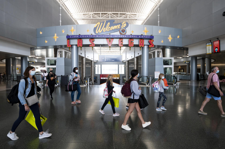 Airline passengers wearing face masks arrive and depart the D Concourse at McCarran International Airport in Las Vegas on Tuesday, June 30, 2020. (Photo By Bill Clark/CQ-Roll Call, Inc via Getty Images)