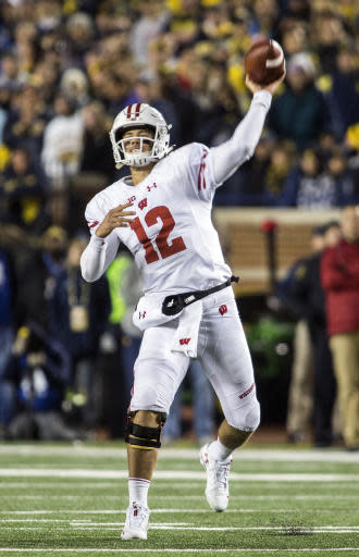 Wisconsin quarterback Alex Hornibrook throws a pass during the fourth quarter of the team's NCAA college football game against Michigan in Ann Arbor, Mich., Saturday, Oct. 13, 2018. Michigan won 38-13. (AP Photo/Tony Ding)
