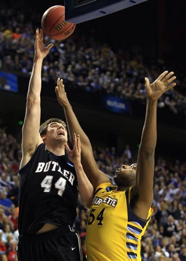 Butler center Andrew Smith (44) shoots as Marquette forward Davante Gardner (54) defends in the first half of a third-round NCAA college basketball tournament game on Saturday, March 23, 2013, in Lexington, Ky. (AP Photo/James Crisp)