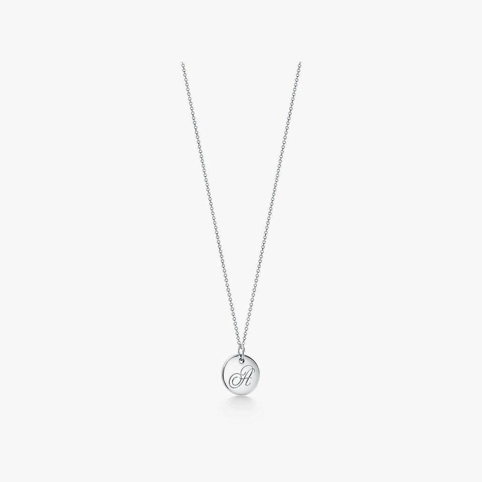 "$172, TIFFANY & CO.. <a href=""https://www.tiffany.com/jewelry/necklaces-pendants/tiffany-notes-letter-a-disc-charm-GRP03133/tiffany-notes-letter-a-disc-charm-25875036/"" rel=""nofollow noopener"" target=""_blank"" data-ylk=""slk:Get it now!"" class=""link rapid-noclick-resp"">Get it now!</a>"