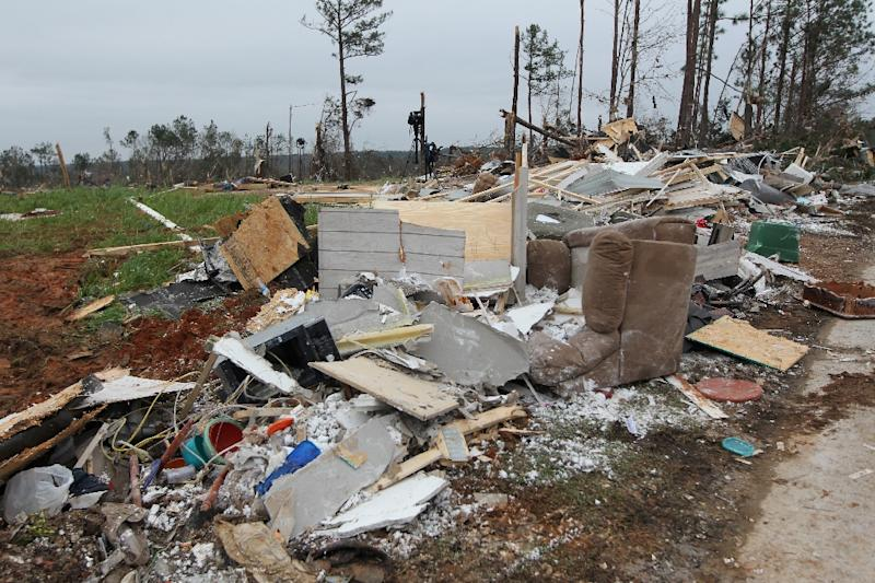 Rescuers sift through debris left by the tornadoes (AFP Photo/Tami Chappell)