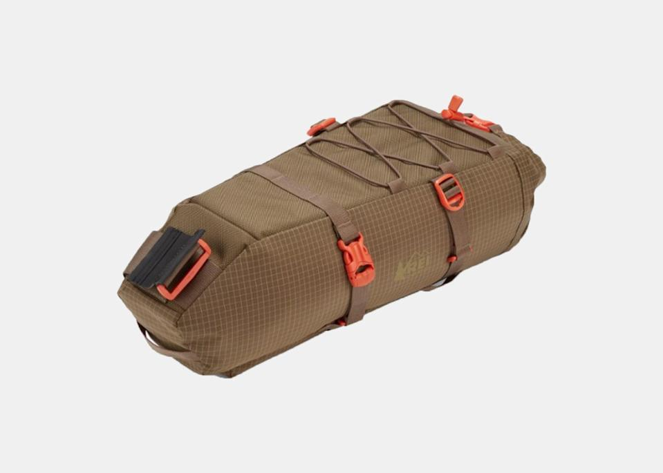 """REI's seat pack is held in place at the back of your bike, with Velcro and side-release buckles that allow for easy removal. Plus, there's a shock-cord on top to stash your jacket in place, just in case the 11-liter main storage compartment isn't roomy enough. Meant to stay stable on both trails and paved roads, the seat pack is made using REI's Bluesign-approved materials, which promote conserving resources and protecting the environment during the manufacturing process (so you can feel especially good about your purchase). $80, REI. <a href=""""https://www.rei.com/product/167663/rei-co-op-link-seat-pack"""" rel=""""nofollow noopener"""" target=""""_blank"""" data-ylk=""""slk:Get it now!"""" class=""""link rapid-noclick-resp"""">Get it now!</a>"""