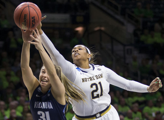 Villanova's Adrianna Hahn (31) competes for a rebound with Notre Dame's Kristina Nelson (21) during a second-round game in the NCAA women's college basketball tournament Sunday, March 18, 2018, in South Bend, Ind. (AP Photo/Robert Franklin)